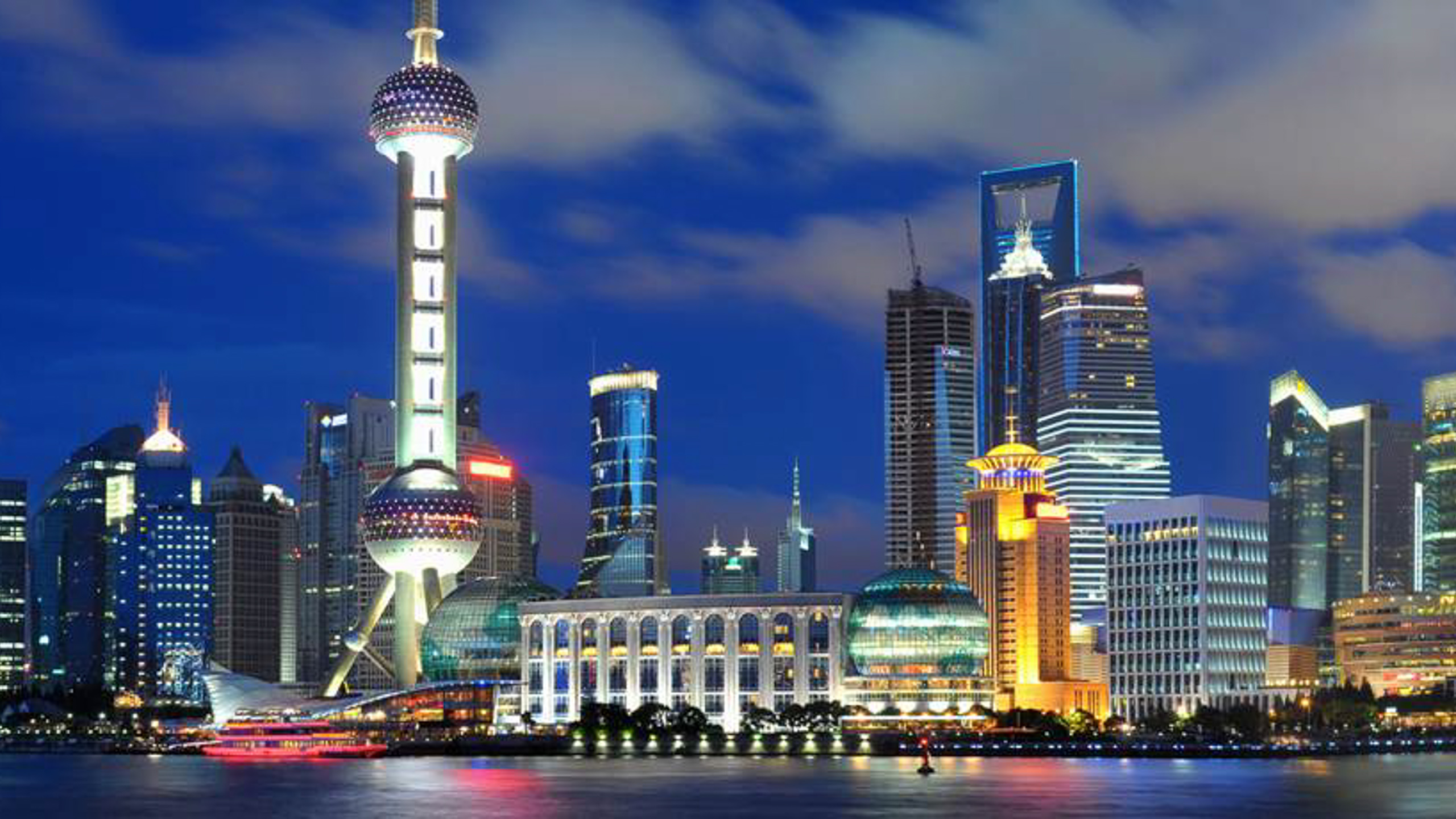 The Shanghai skyline at night with A&K